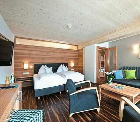 Blick in ein Zimmer_Familien_Sporthotel_Brennseehof_Feld_Am_See