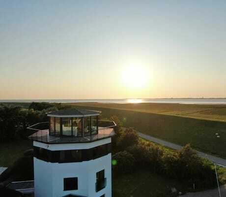 Leuchturm im Sonnenuntergang_Lundenbergsand